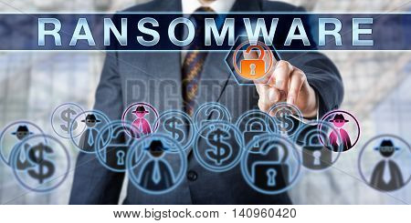 Corporate manager is touching RANSOMWARE on an interactive control screen. Information security concept for the crime of extorting ransom money via computer malware causing a access restrictions.