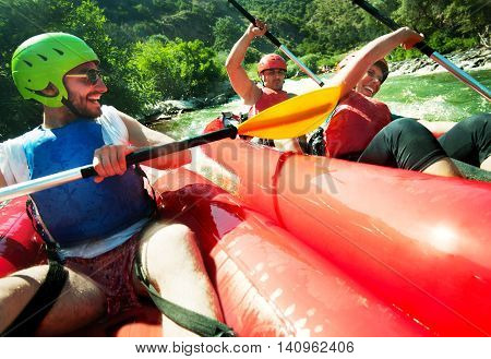 Two red inflatable canoes collision in fast waters of a river.