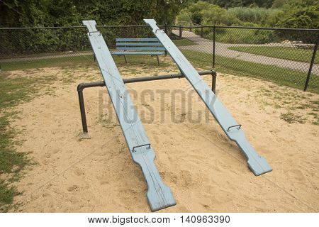 Old school seesaws ready for use in a local playground