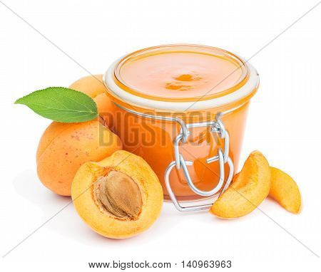 Apricot jam and fresh fruits isolated on white background