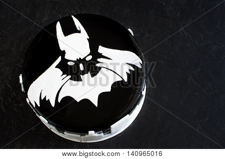 Batman birthday cake, coated with black chocolate icing with chocolate mousse