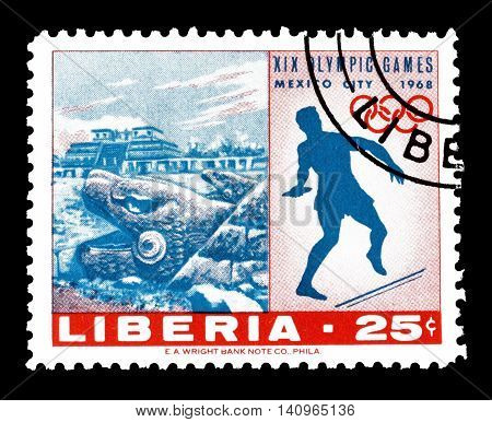 LIBERIA - CIRCA 1968 : Cancelled postage stamp printed by Liberia, that shows Discus pyramid and serpent god.