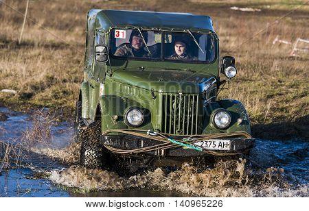 LvivUkraine- December 6 2015: Off-road vehicle brand GAZ - 69 overcomes the track on a polygon near the city Lviv Ukraine