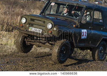 LvivUkraine- December 6 2015: Unknown rider on the off-road vehicle brand UAZ overcomes a route off road near the city of Lviv Ukraine
