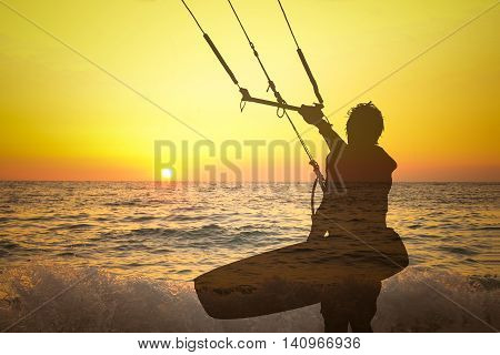 Transparent silhouette double exposure of kite surfer on the beach at sunset. Sport, summer and vacation concepts.