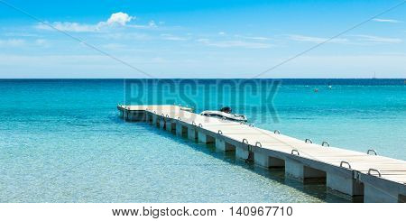 Pontoon  In The Turquoise Water Of  Rondinara Beach In Corsica Island In France
