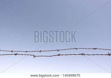 Rusty Barbed Wire Fence  Closeup