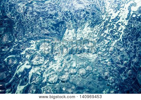 toned clear water whirlpool with bubbles and ripples