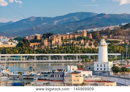 Malaga, Spain townscape with the lighthouse and Alcazaba.