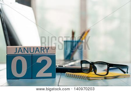 January 2nd. Day 2 of month, calendar on business office background. Winter time. Empty space for text.