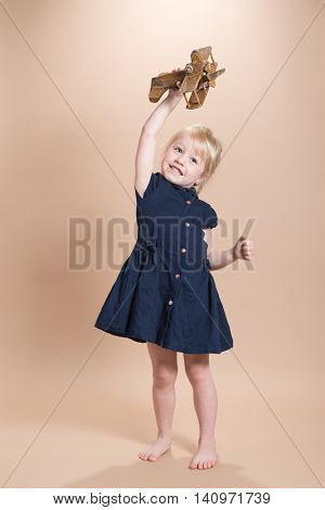 Little girl playing with her aeroplane