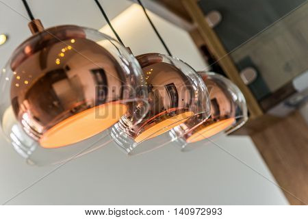 Three chandeliers or lamps in modern home interior