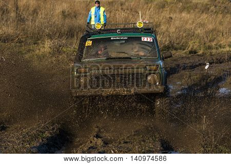 LvivUkraine- December 6 2015: Unknown rider on the off-road vehicle brand VAZ-NIVA overcomes a route off road near the city of Lviv Ukraine