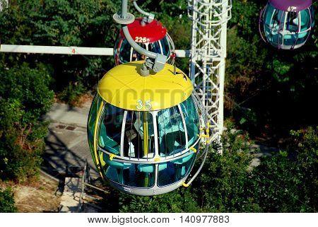 Hong Kong China - January 2 2008: Cable car gondola #35 high above the headland forested hills at Ocean Park *