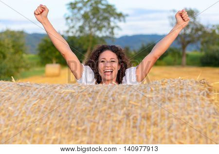 Excited Young Woman Celebrating In A Farm Field