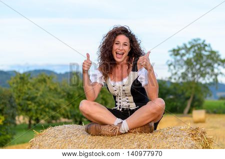 Happy Exited Woman Sitting On A Hay Bale