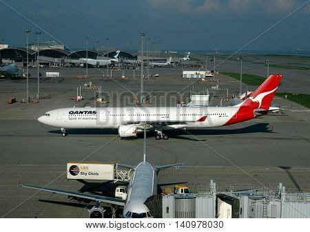 Hong Kong China - May 20 2004: A Quantas Airlines plane taxis on the tarmac at Hong Kong International Airport