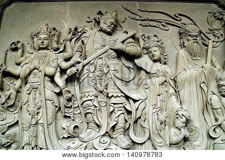 Hong Kong China - December 12 2006: Bas relief Chinese carvings cover a wall at the Po-Lin Monastery on Lantau Island