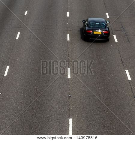 SELSTON ENGLAND - AUGUST 1: A car on the 4-lane section of the M1 motorway looking North. In Selston Nottinghamshire England. On 1st August 2016.