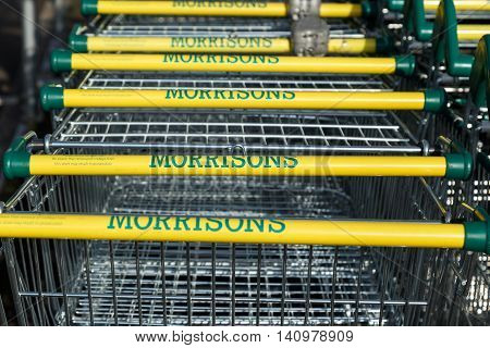 KIRKBY IN ASHFIELD ENGLAND - AUGUST 1: Array of Morrisons supermarket trollies lined up in the trolley bay. On 1st August 2016. In Kirkby In Ashfield Nottinghamshire England.
