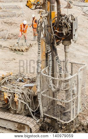 ILKESTON ENGLAND - AUGUST 1: Detail of pile drilling machine with helical screw fitted. In Ilkeston Derbyshire England. On 1st August 2016.