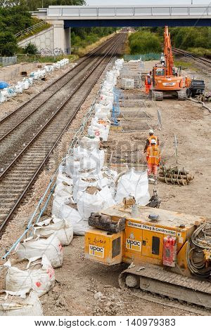 ILKESTON ENGLAND - AUGUST 1: Pile drilling machine on site next to a section of railway track. In Ilkeston Derbyshire England. On 1st August 2016.