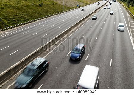 SELSTON ENGLAND - AUGUST 1: 2 Various vehicles on the 4-lane section of the M1 motorway looking South. In Selston Nottinghamshire England. On 1st August 2016.