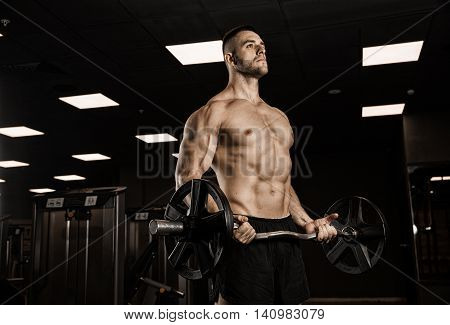 muscular body building men training at the gym