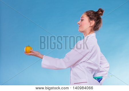 Scientist Doctor With Apple And Syringe. Gm Food.