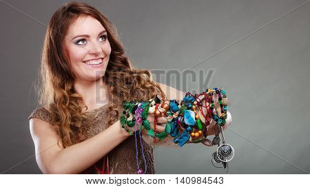 Pretty Woman With Jewelry Necklaces Beads And Hat.