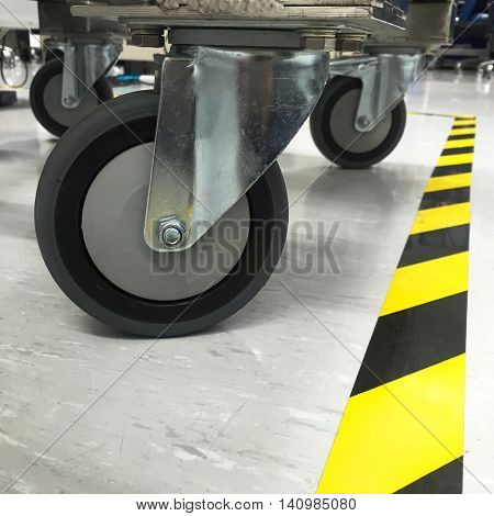 Trolley wheels made of antistatic resin for use in the factory.