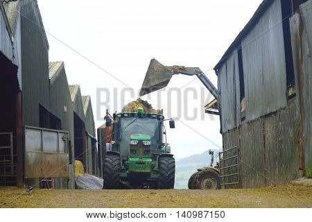 Loading tractor on a farm in Devon