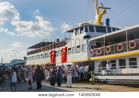 Istanbul Turkey - July 26 2016: Istanbul Eminönü pier ferry ticketless special day dense crowd. Istanbul municipality after the failed coup attempt of July 15 temporary public transport was free.