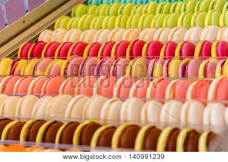 Set of different french cookies macaroons macaroons in a paper box. Top view. Closeup. Coffee, chocolate, vanilla, lemon, raspberry, strawberry, pistachio, violet, rose, orange tastes macaroons