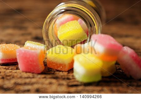 jelly sweets and sugars with glass bottle, selective focus yellow jelly in glass bottle