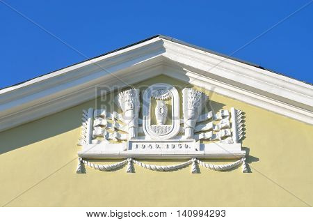 Bas-relief on building in the style of Stalin in Metallostroy outskirts of St. Petersburg Russia.