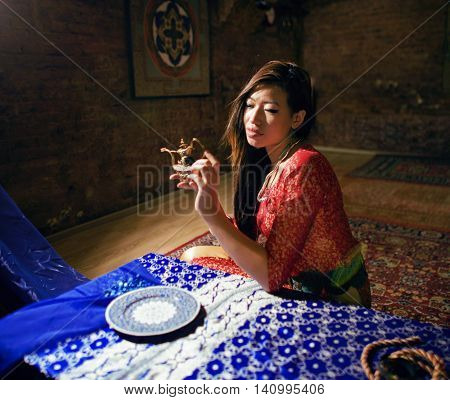 beautiful asian woman in oriental styled interior, magical people close up
