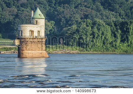 Historic water intake tower number 1 built in 1894 below the Old Chain of Rocks bridge on the Mississippi River near St Louis
