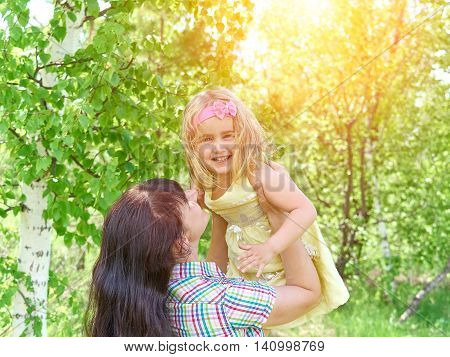 Mother Playing With Her  Little Daughter On Nature