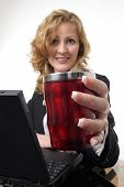 Business Woman Offering A Cup Of Coffee