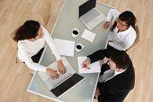 foto of business meetings  - Overhead view of business meeting - JPG