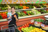 image of grocery store  - Woman and baby in grocery store - JPG