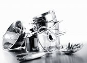 Pile of pots and pans against a white background