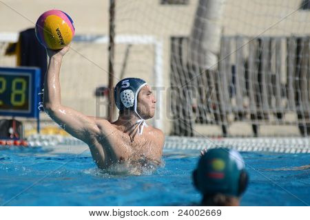 KAPOSVAR, HUNGARY - OCTOBER 1: Ferenc Salamon in action at a Hungarian national championship water-polo game between Kaposvar (white) and Honved (green) on October 1, 2011 in Kaposvar, Hungary