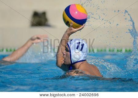 KAPOSVAR, HUNGARY - OCTOBER 1: Romeo Kutasi in action at a Hungarian national championship water-polo game between Kaposvar (white) and Honved (green) on October 1, 2011 in Kaposvar, Hungary