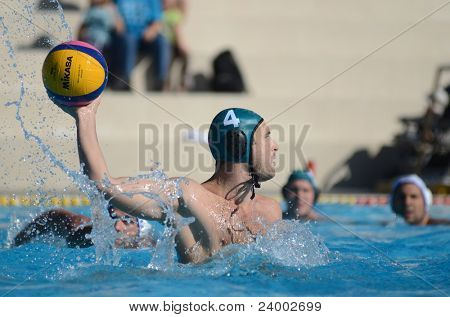 KAPOSVAR, HUNGARY - OCTOBER 1: Zoltan Matyas (g 4) in action at a Hungarian national championship water-polo game between Kaposvar (white) and Honved (green) on October 1, 2011 in Kaposvar, Hungary