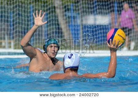 KAPOSVAR, HUNGARY - OCTOBER 1: Unidentified players in action at a Hungarian national championship water-polo game between Kaposvar (white) and Honved (green) on October 1, 2011 in Kaposvar, Hungary