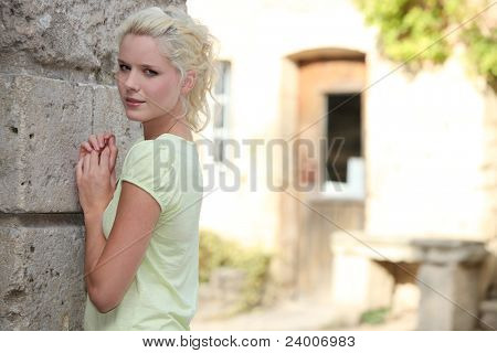 pretty girl facing a wall