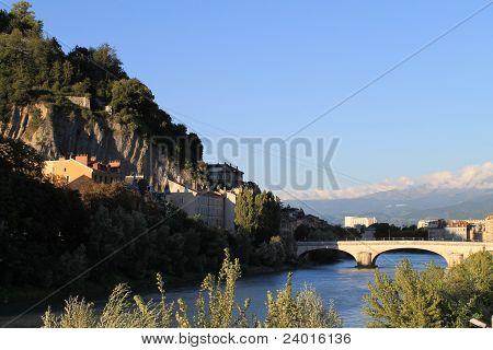 Bridge over Isere with view towards Alps