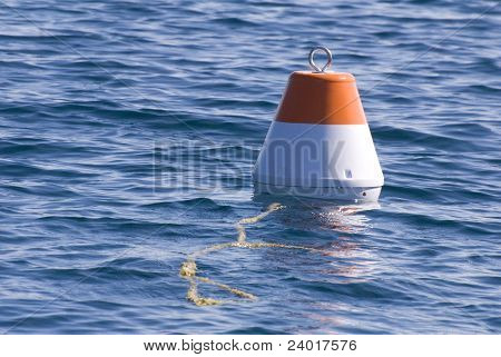 A Red and White Buoy Float